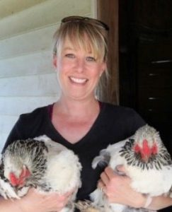 Stephanie Peterson holds two chickens