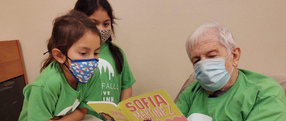 Volunteer David Wegner reads to Kid Link guests